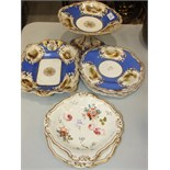 A Copeland and Garrett blue and gilt part dessert service decorated with vignettes including