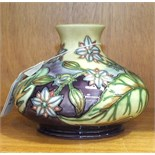 """A late-20th century Moorcroft """"Borage"""" pattern vase of squat globular form, decorated with blooms"""