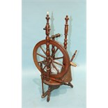An antique turned wood spinning wheel, 88cm high, (a/f).