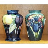 A small Moorcroft vase decorated with orchids, 9cm high, impressed Moorcroft, Made in England to