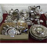 A collection of plated cutlery and other plated ware, including spill vases, bowls, a hot water jug,