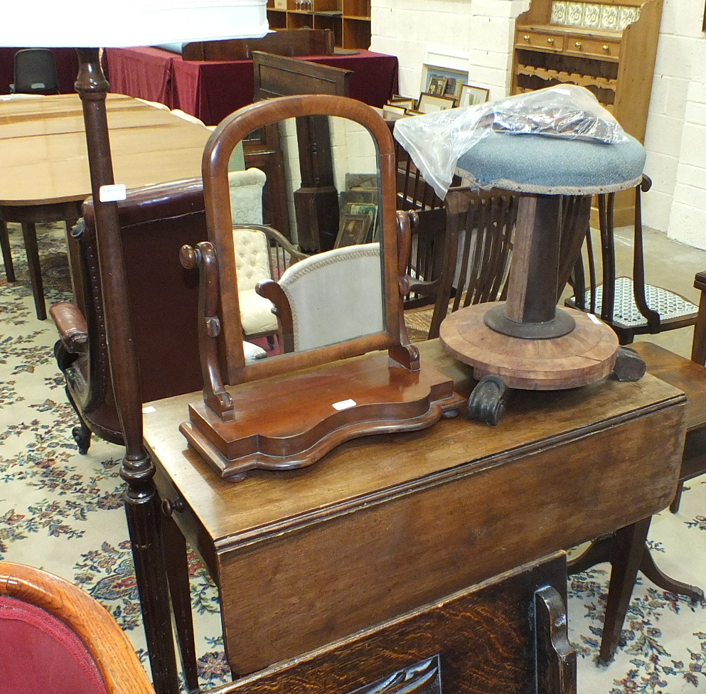 Lot 34 - A mahogany Pembroke table with end drawer on square tapered legs, a damaged revolving piano stool, a