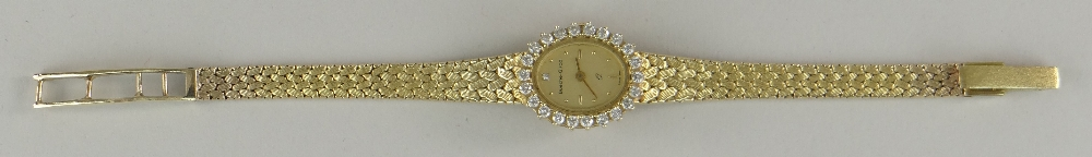 9CT YELLOW GOLD LADIES BUECHE-GIROD COCKTAIL WATCH, the oval dial surrounded by twenty-two - Image 2 of 4