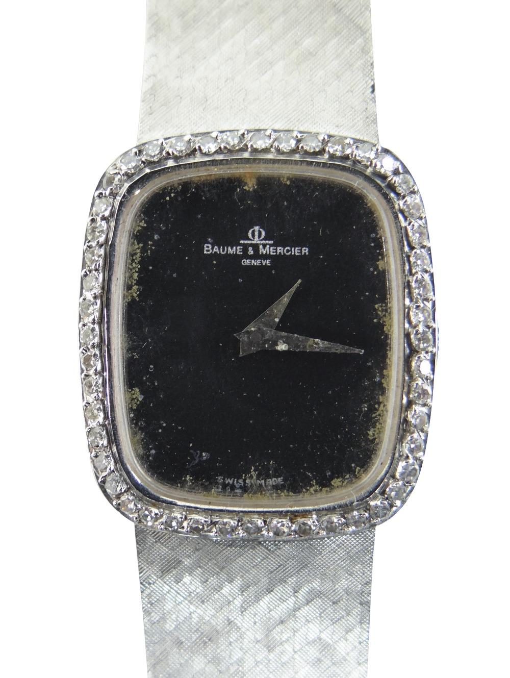 18CT WHITE GOLD (750) BAUME & MERCIER WRISTWATCH having diamond set bezel and integrated strap, 47.4