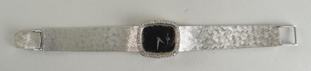 18CT WHITE GOLD (750) BAUME & MERCIER WRISTWATCH having diamond set bezel and integrated strap, 47.4 - Image 2 of 4