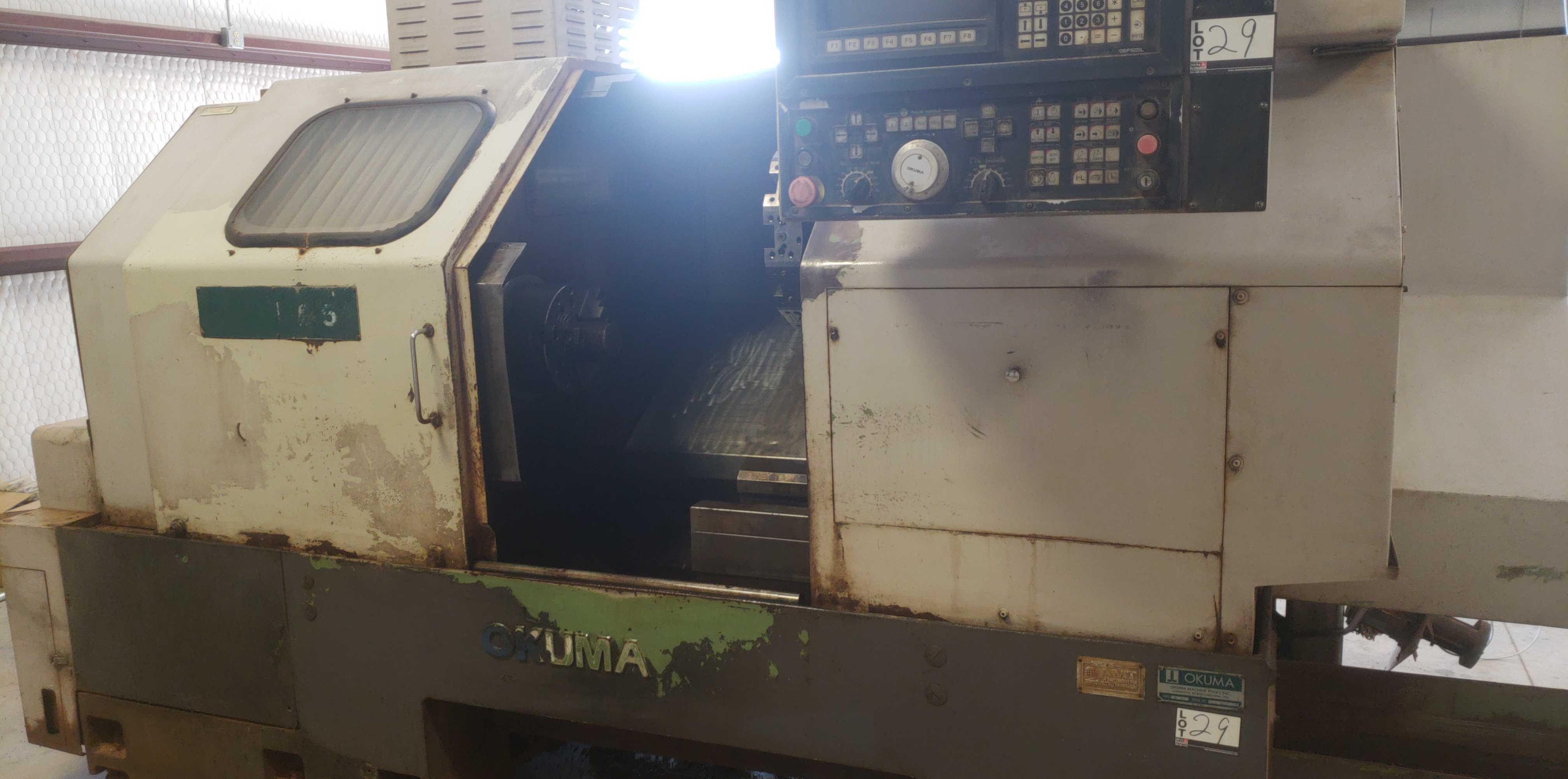 """Okuma LB 25 2 Axis CNC lathe, 5020 control, chip conveyor, 10"""" chuck SN: 06119625"""