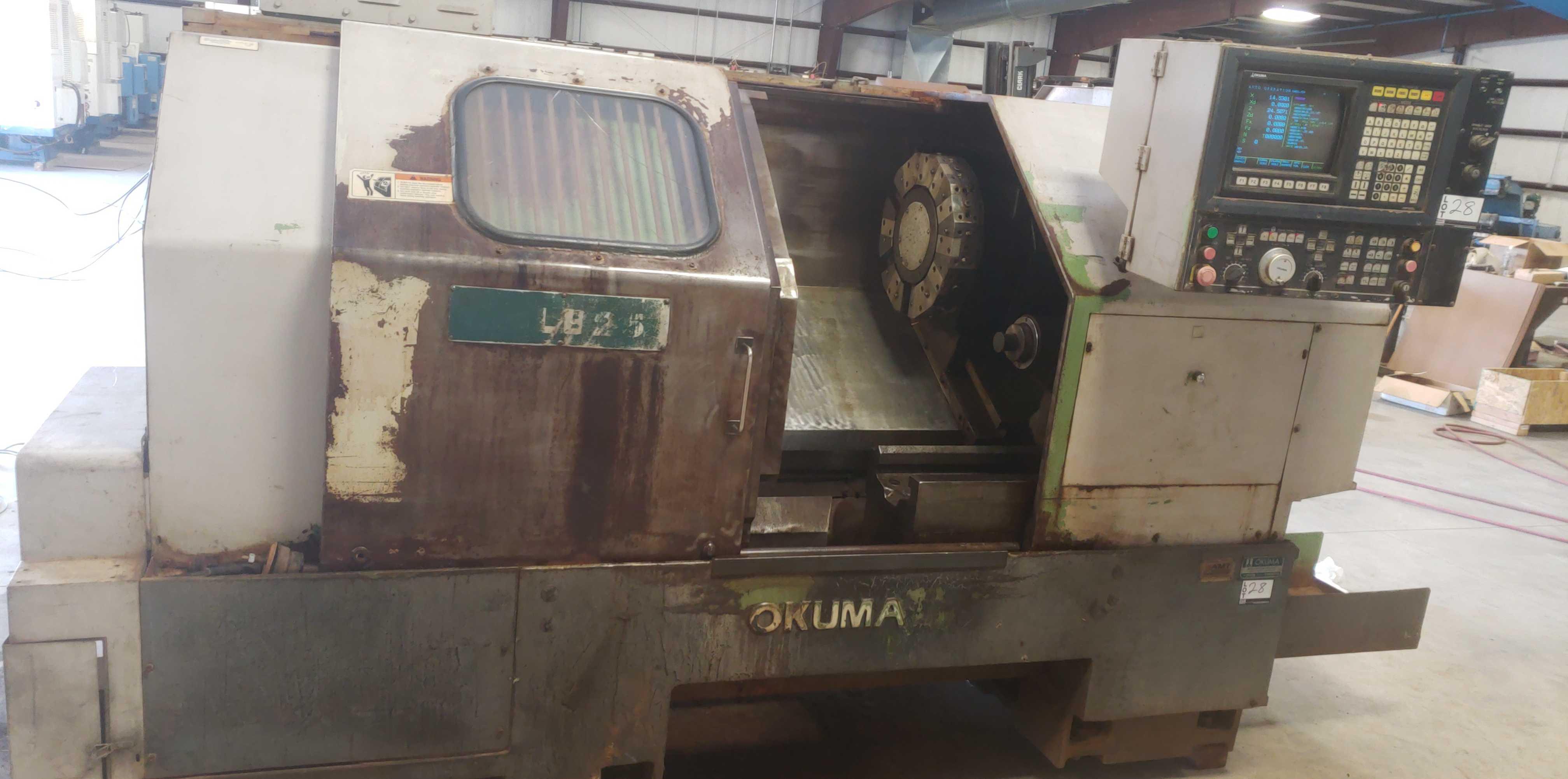 """Okuma LB 25 2 Axis CNC lathe, 5020 control, chip conveyor, 10"""" chuck SN: 07049681"""
