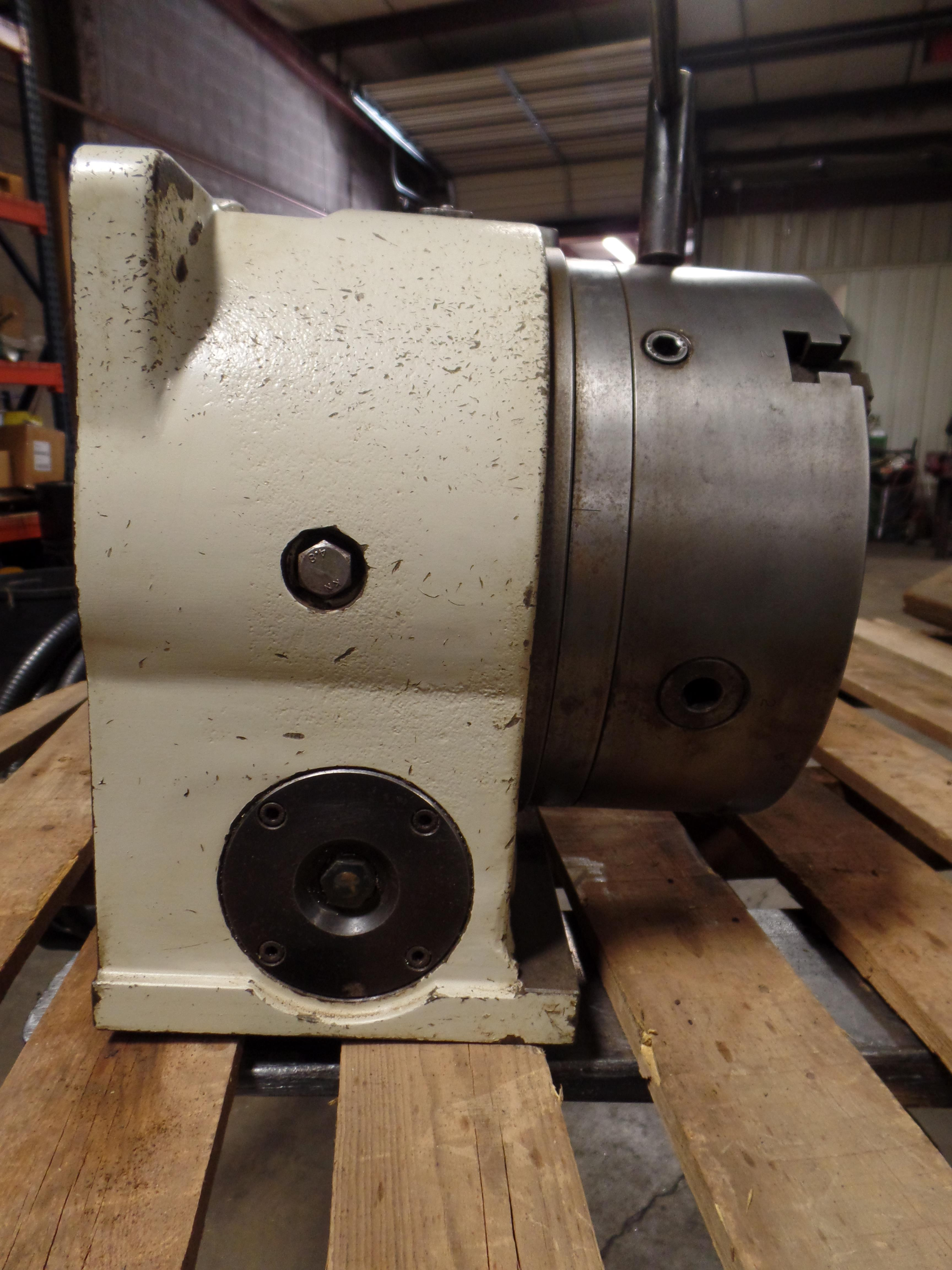 "Lot 51 - Yuasa 4th Axis Indexer w/ control box and steady rest, 11"" 3 jaw chuck w/hard jaws, model UDX-28001"