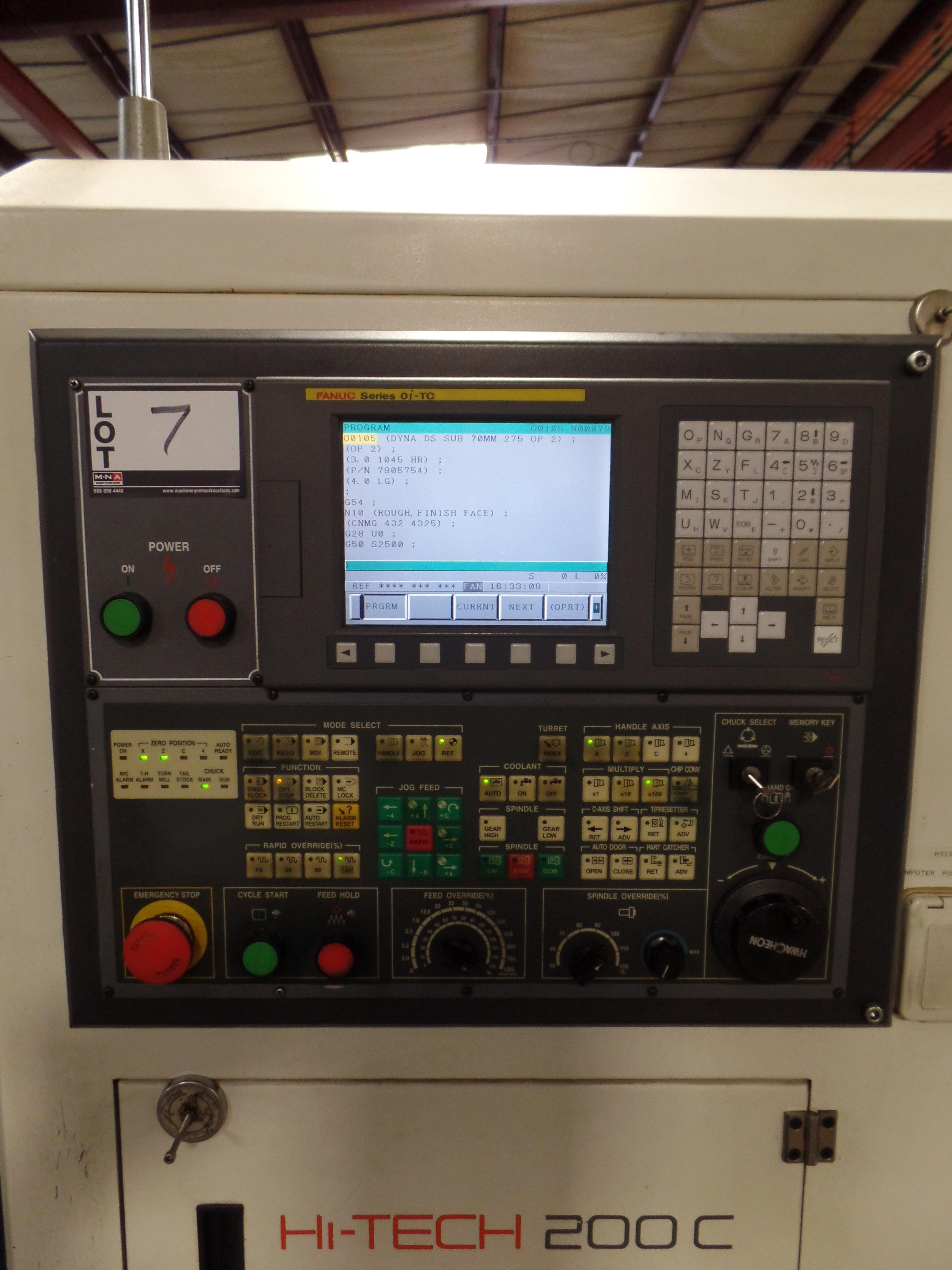 "Lot 7 - 2006 Hwacheon Hi-Tech 200C 2 Axis CNC Lathe, Fanuc Oitc control, 10"" chuck, chip conveyor SN:"
