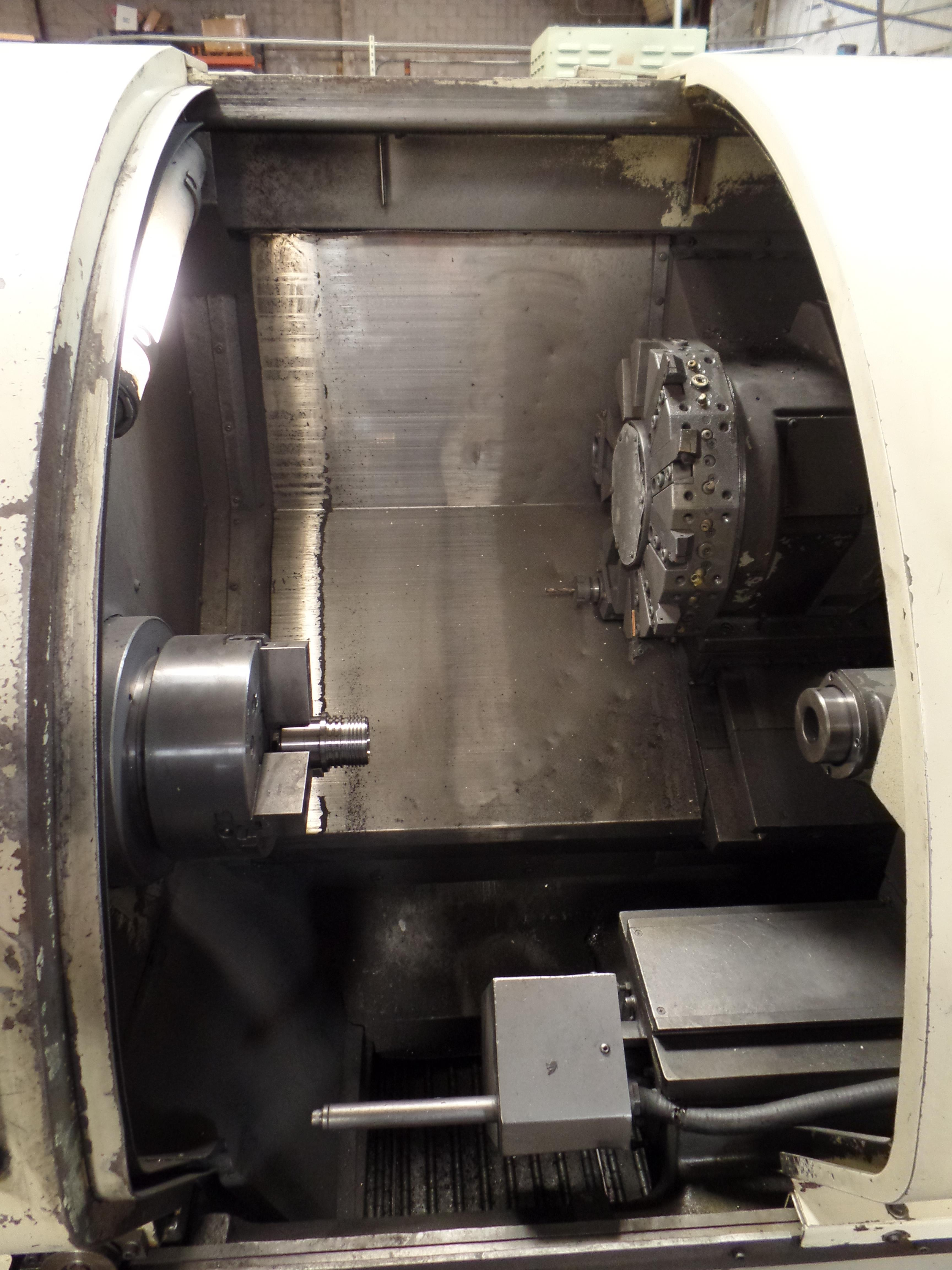 1999 Okuma Crown 762SBB big bore 2-axis CNC turning center with LNS bar feed, OSP700L control, parts - Image 14 of 16