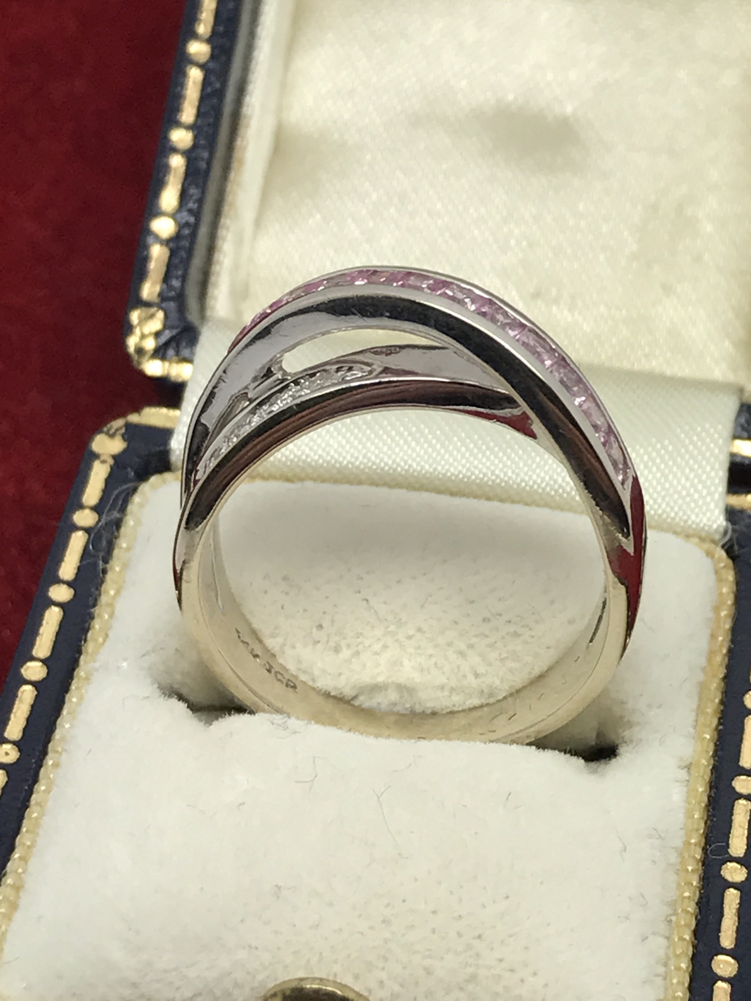 Lot 29 - 14CT WHITE GOLD PINK SAPPHIRE & DIAMOND CROSSOVER RING