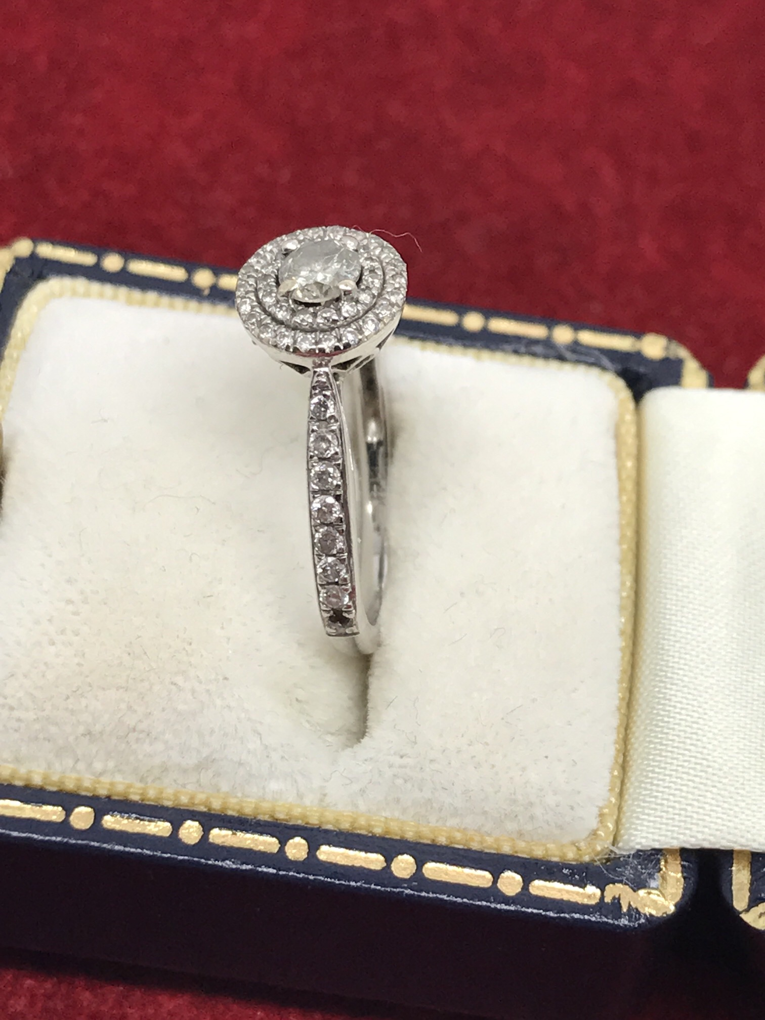 Lot 31 - 14k WHITE GOLD HALO DIAMOND RING