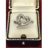FINE DIAMOND SET HEART RING IN WHITE METAL TESTED AS 18ct GOLD