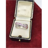 14CT WHITE GOLD PINK SAPPHIRE & DIAMOND CROSSOVER RING