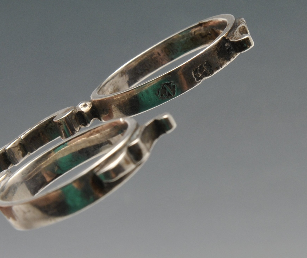 Lot 524 - Two similar pairs of Georgian silver scissor sugar tongs, each with scroll arms with shell bowls and