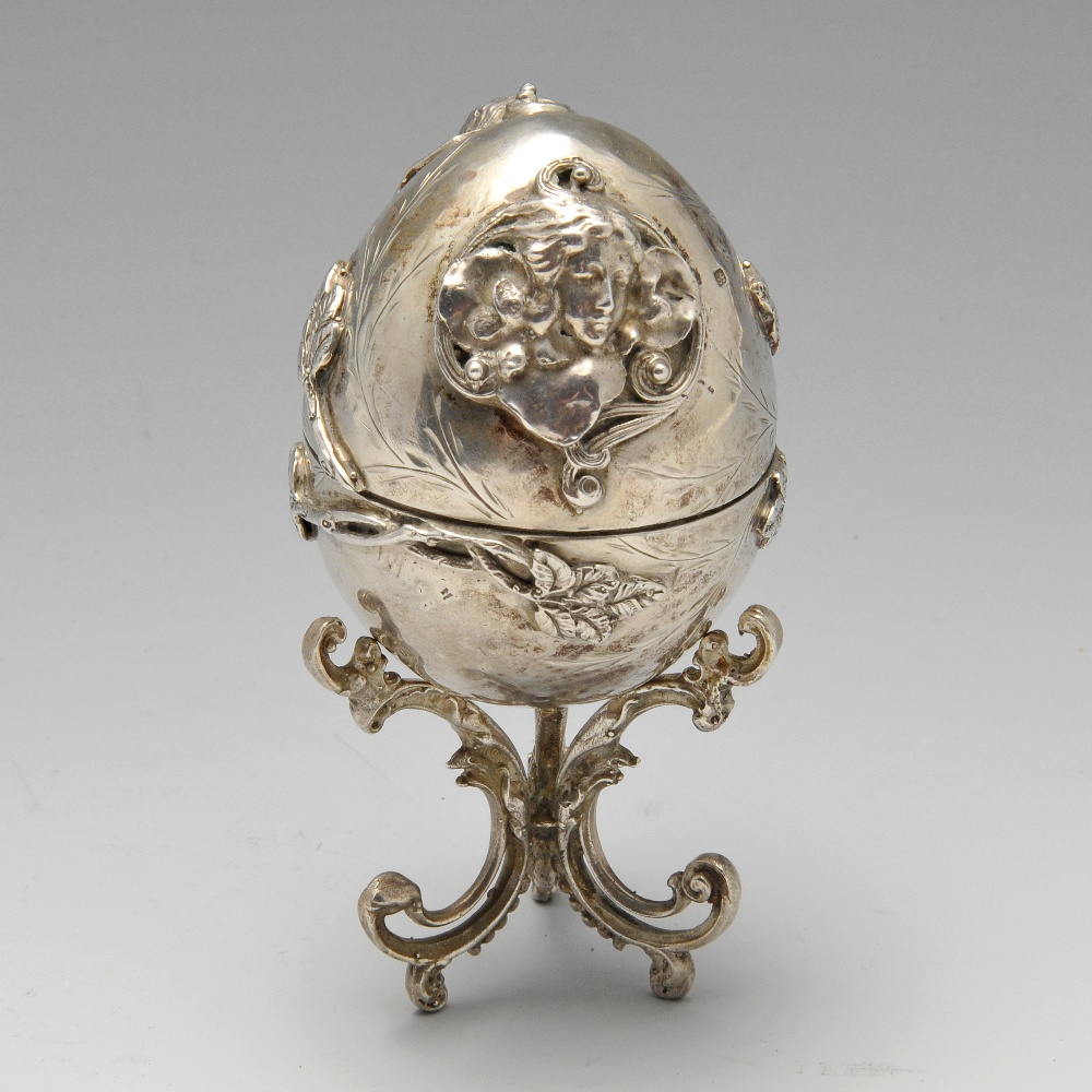 Lot 682 - A late nineteenth century Eastern European egg ornament on stand, applied decoration of twin opposed