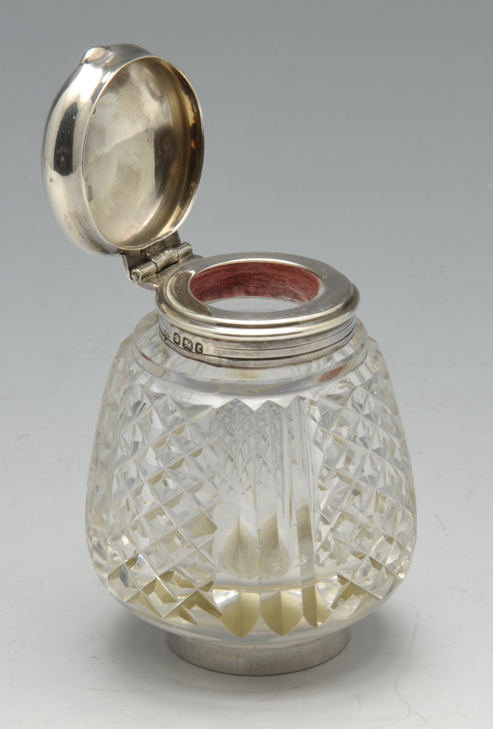 Lot 368 - A late Victorian silver inkstand of rounded rectangular form with beaded rim and raised on four