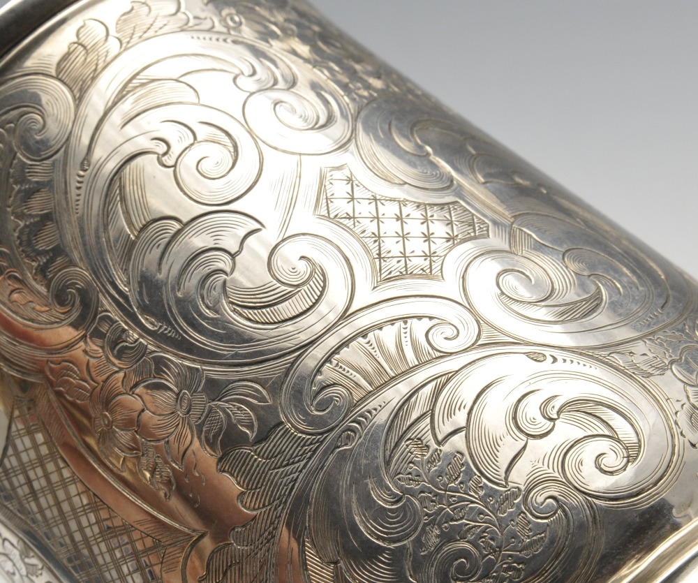 Lot 11 - A George II silver mug, the tapered body with later floral scroll and scenic engraving surrounding