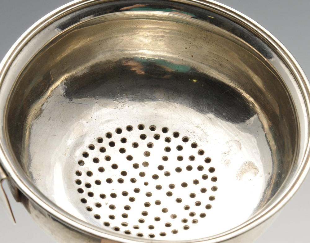 Lot 69 - A George III silver wine funnel of conventional form with simple drill-pierced sieve. Hallmarked