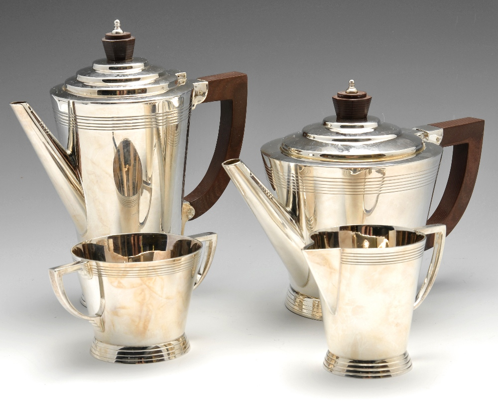 Lot 260 - A 1960's silver four piece tea service, comprising teapot, coffee pot, milk jug and twin handled