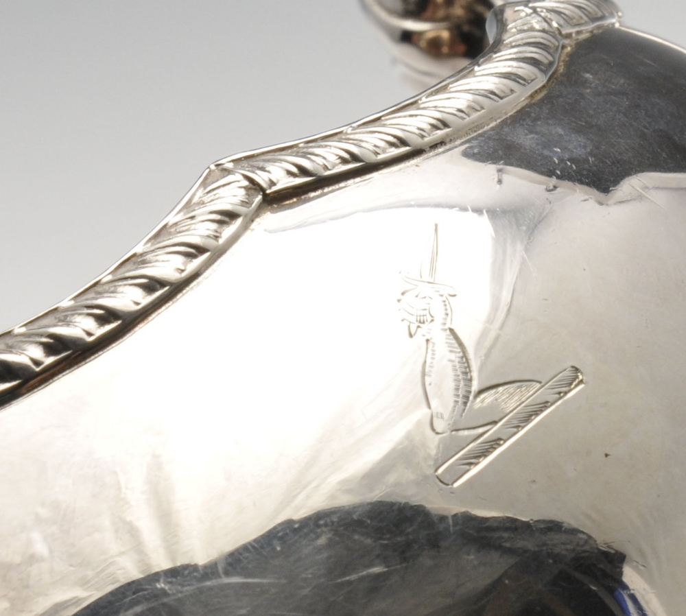 Lot 242 - A matched pair of modern silver sauce boats, each of typical bellied form with shaped gadroon rim