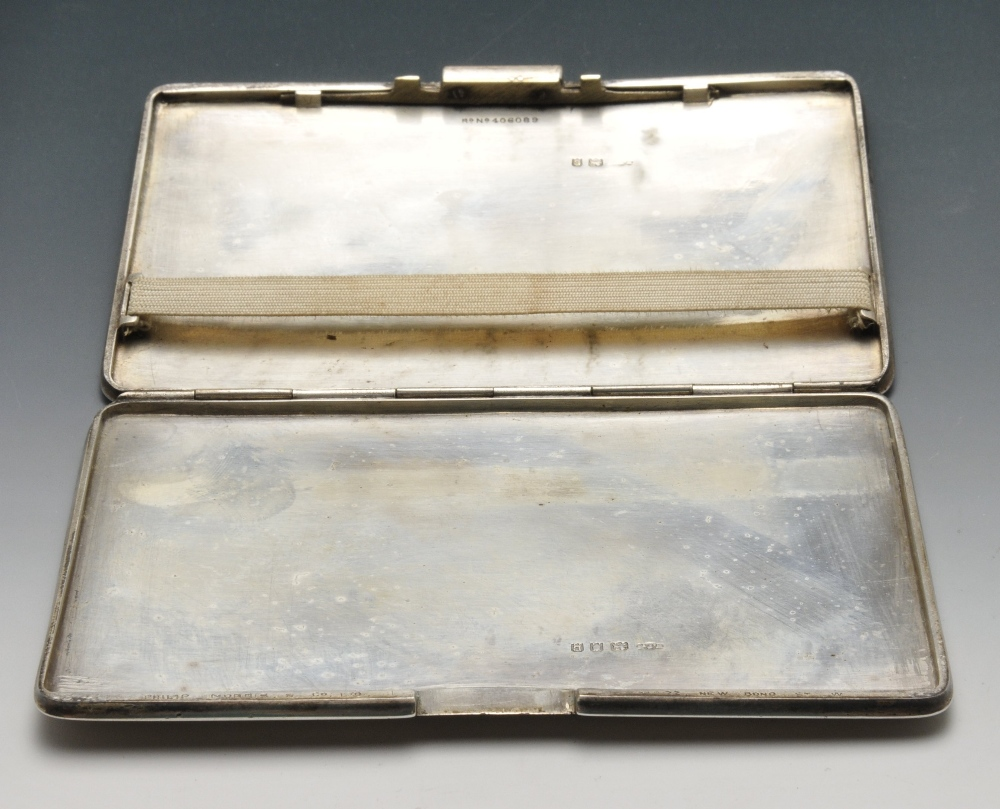 Lot 695 - An early twentieth century silver cigarette case of oblong form and engine-turned decoration with