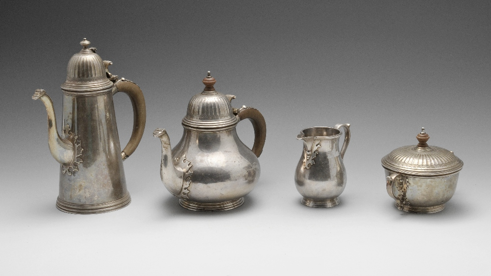 Lot 251 - A 1960's silver four piece tea service, comprising teapot, coffee pot, milk jug and twin-handled