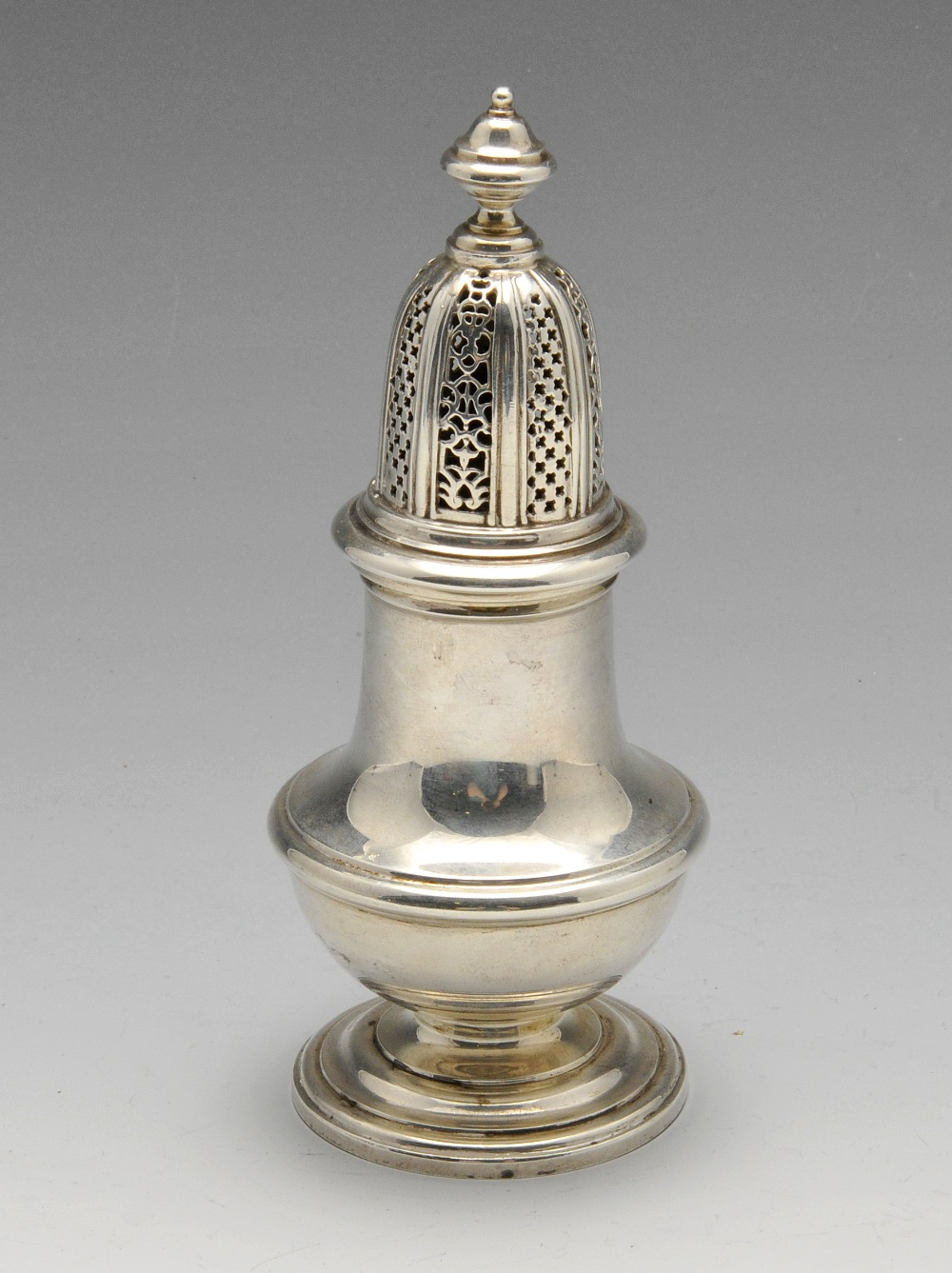 Lot 247 - A modern silver caster in Georgian style, the vase shaped body with embossed girdle, raised on a