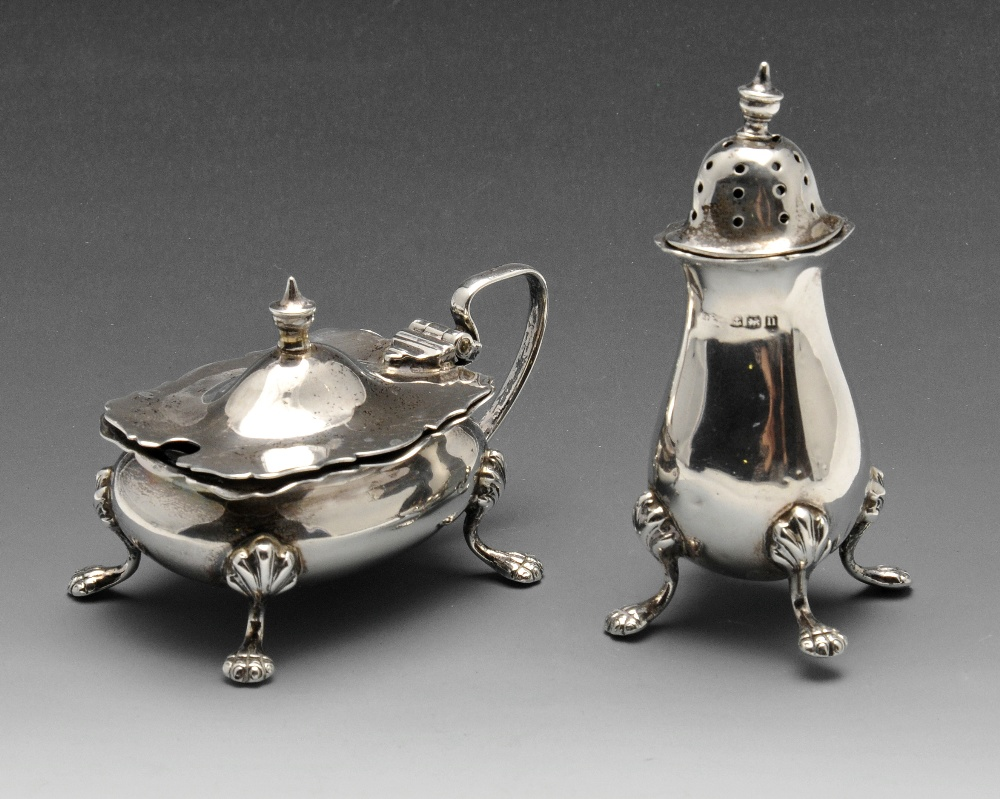 Lot 177 - An early twentieth century silver pepper pot and a matching mustard pot with blue glass liner,