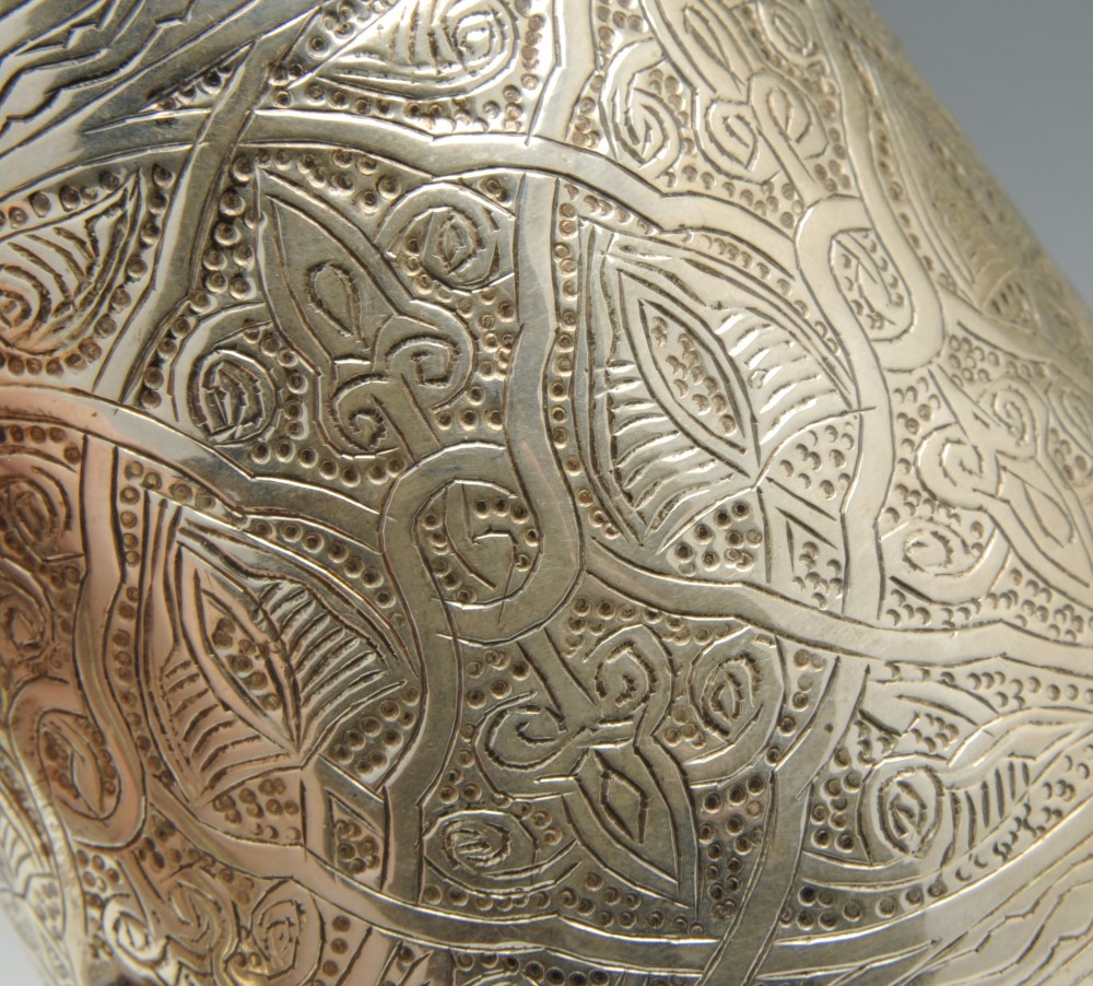 Lot 475 - An Egyptian silver mug with moulded rim above a slightly tapering body and decorated throughout with
