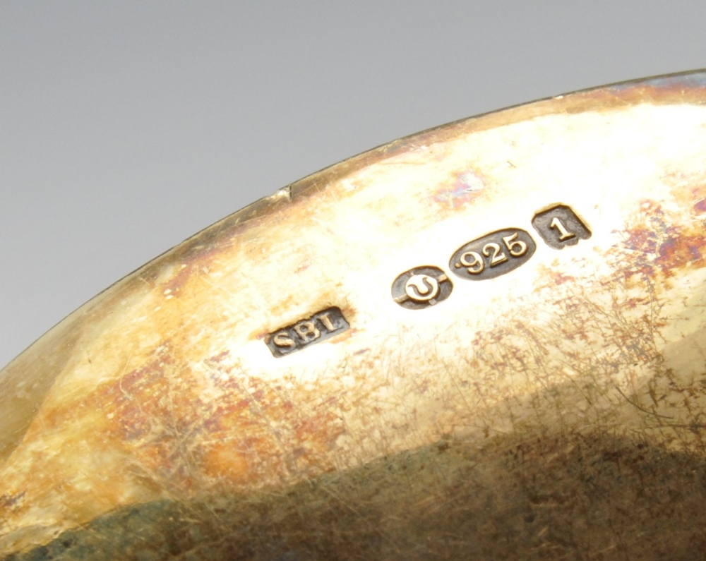 Lot 532 - An Edwardian imported replica silver-gilt Trefid spoon with foliate engraved stem with stylised