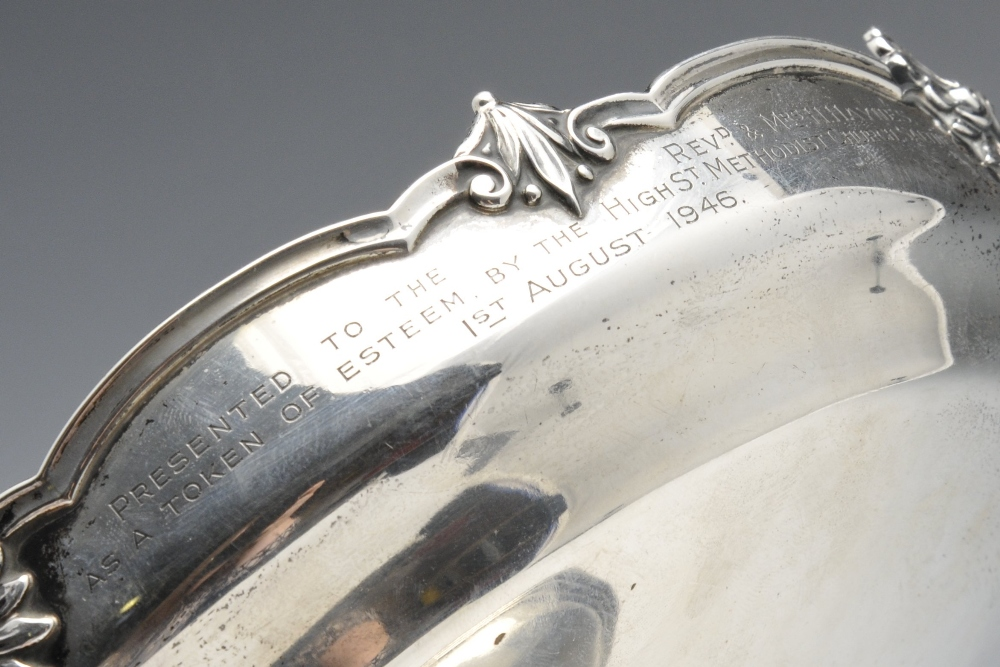 Lot 206 - A 1930's silver pedestal dish of circular form, applied foliate, shell and scroll rim with a later