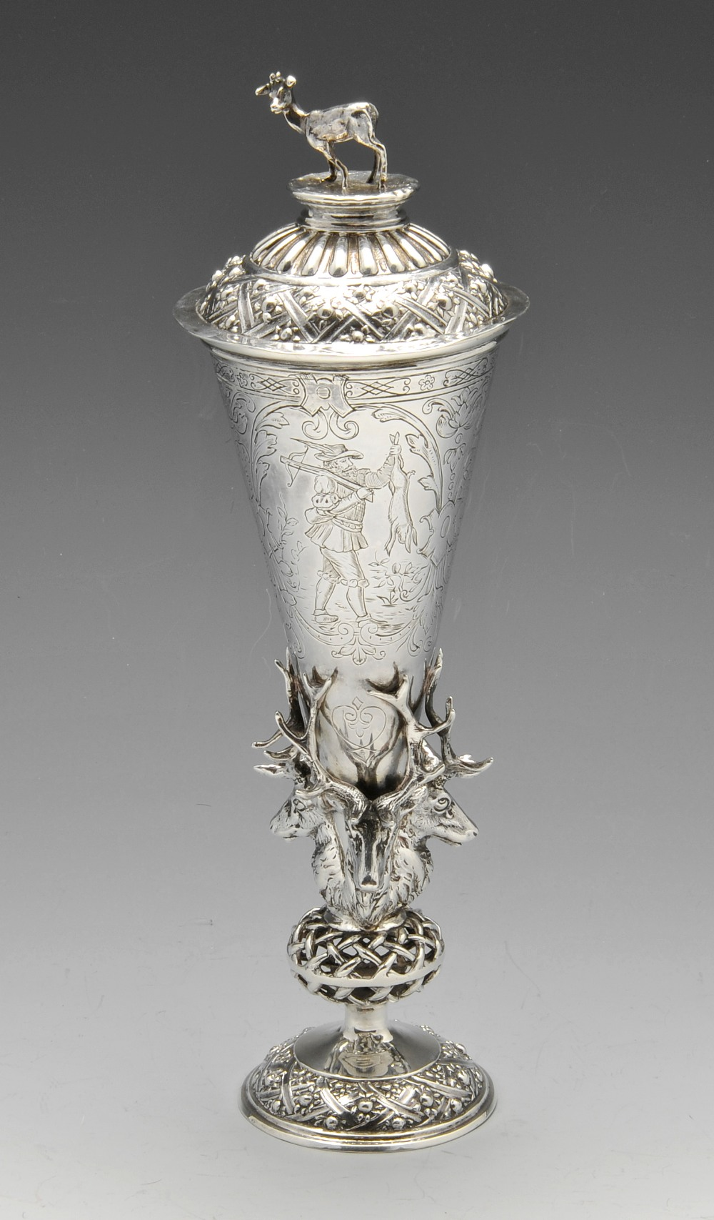 Lot 424 - A late nineteenth century imported silver hunting cup and cover, the conical body engraved with