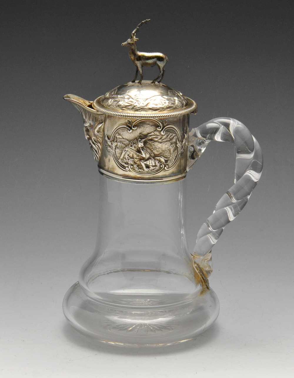Lot 110 - A Victorian silver mounted glass claret jug, of cylindrical form with a bulbous base and rope