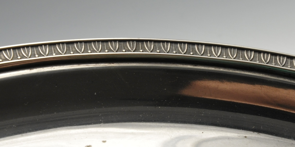 Lot 504 - A large Italian silver tray, of plain circular form having formal leaf border to rim. Marked 800