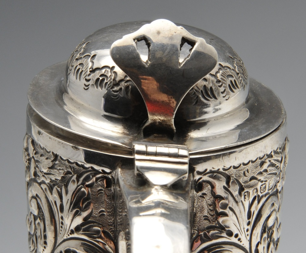 Lot 43 - A George IV silver christening mug decorated with embossed floral and foliate panels and having a