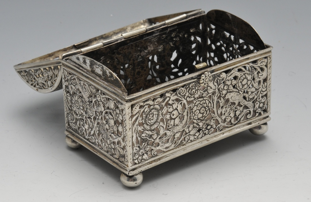 Lot 710 - A continental box of casket form, the oblong open-work form depicting birds amidst floral scrolls,