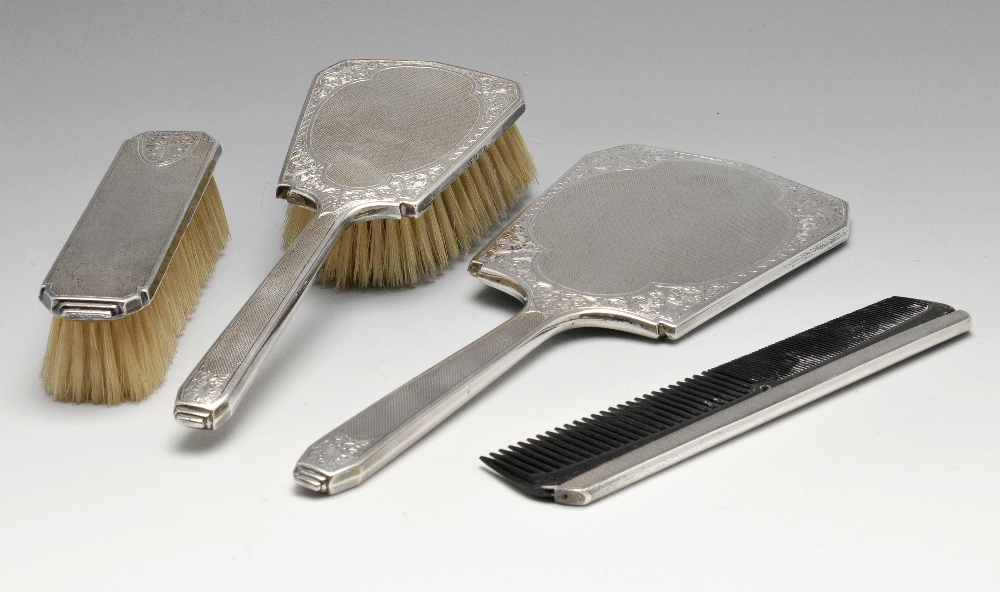 Lot 379 - A 1960's silver mounted four piece dressing table set, comprising clothes brush, hairbrush, comb and