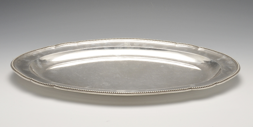 Lot 12 - A George III silver meat dish by Paul Storr, the oval form with dual crests, raised edge with beaded