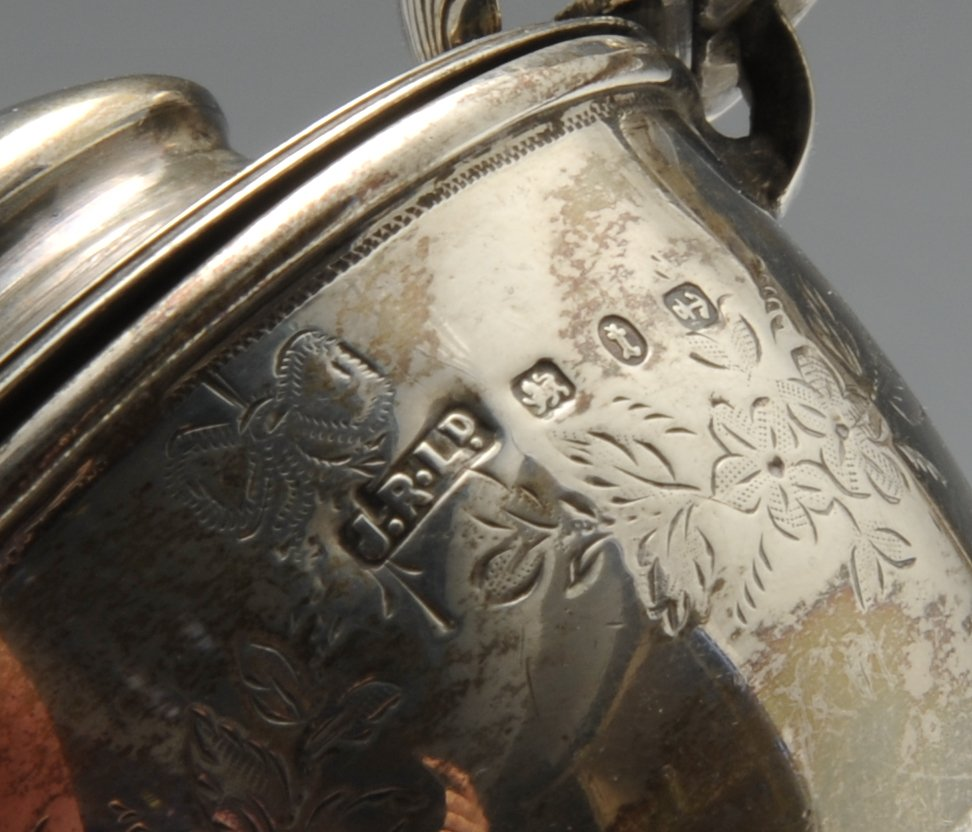 Lot 98 - A late Victorian silver mustard pot of circular pedestal form with floral swag engraving and shell