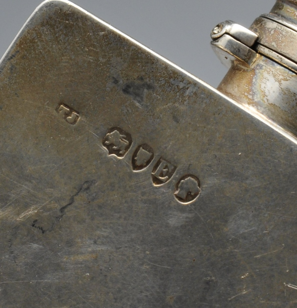 Lot 601 - A Victorian silver hip flask, the oblong form with applied shield, personal inscription and hinged