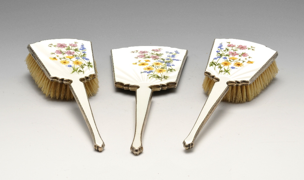 Lot 353 - A 1950's silver mounted three piece dressing table set, comprising hand mirror and two