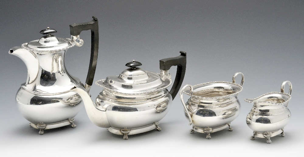 Lot 252 - A 1960's four piece silver tea service, the plain oblong bodies with beaded border and stranding