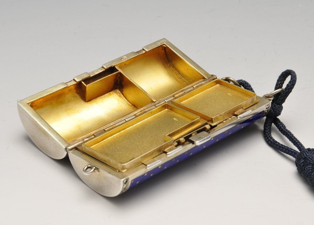 Lot 652 - A 1920's Scottish import silver-gilt and enamel minaudiere, the hinged cylindrical body with blue