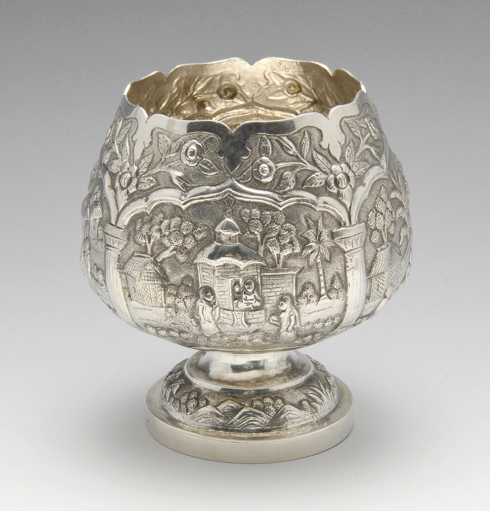 Lot 460 - An Indian style bowl of squat goblet form, ornately decorated throughout with various figurative and