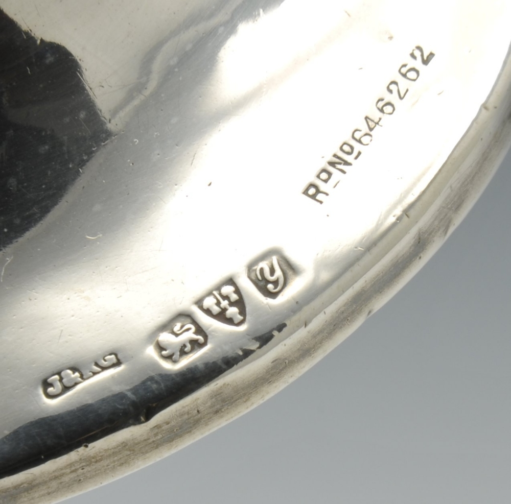 Lot 668 - An early twentieth century silver mounted trinket box of shaped oval outline and raised on four