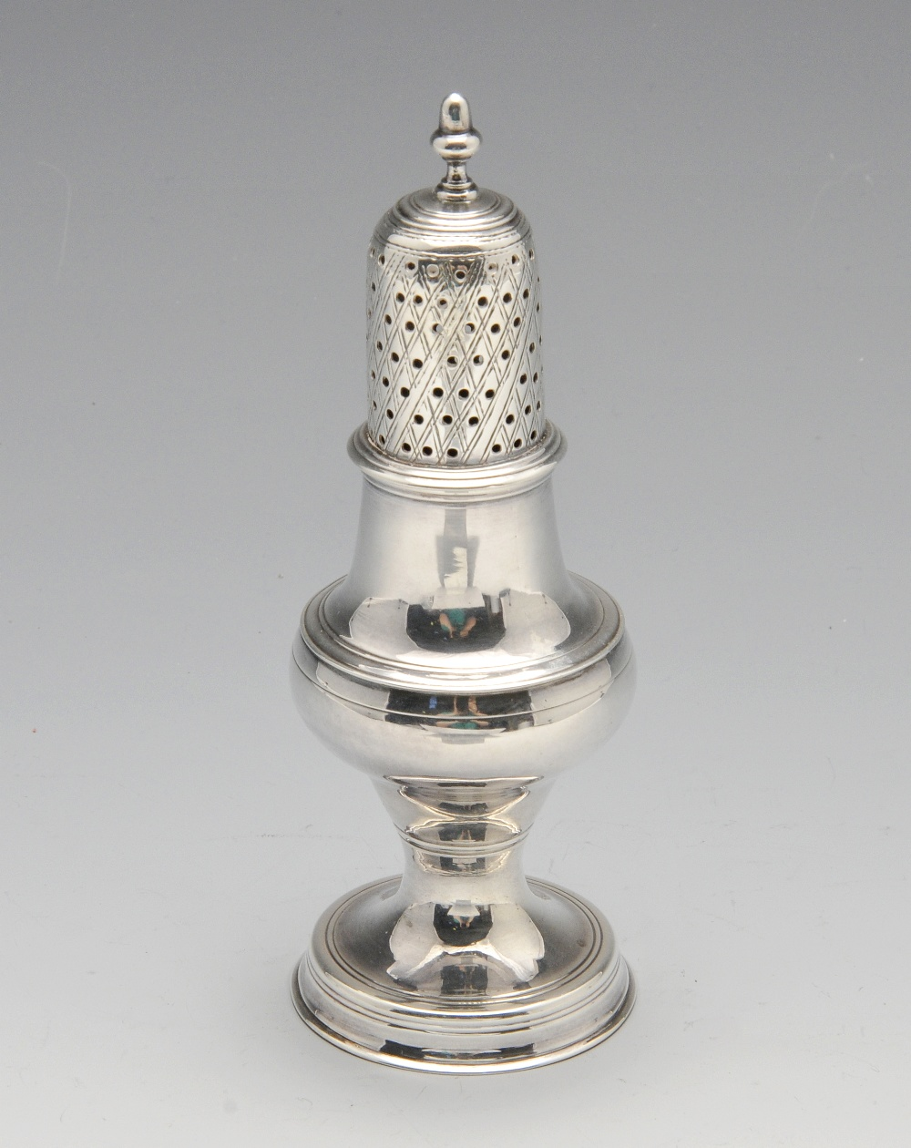 Lot 6 - A George III silver caster of baluster form with diaper pierced cover. Hallmarked Hester Bateman,