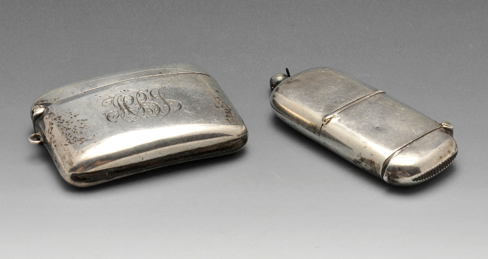 Lot 784 - An early twentieth century silver double vesta case, the slightly curved oblong form with engraved