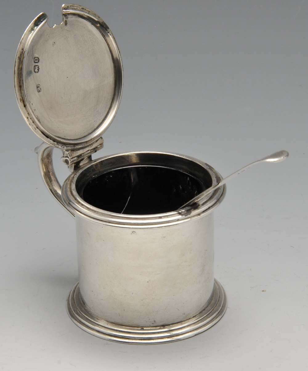 Lot 164 - A Victorian silver drum mustard pot, the plain cylindrical form with crested hinged cover, scroll