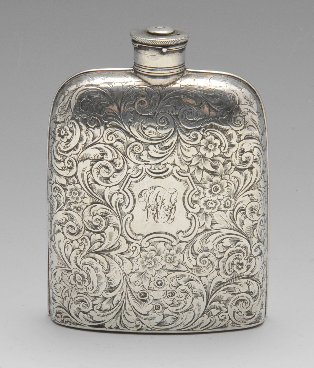 Lot 598 - A Victorian silver hip flask, the pocket form with floral scroll engraving and initialled cartouche.